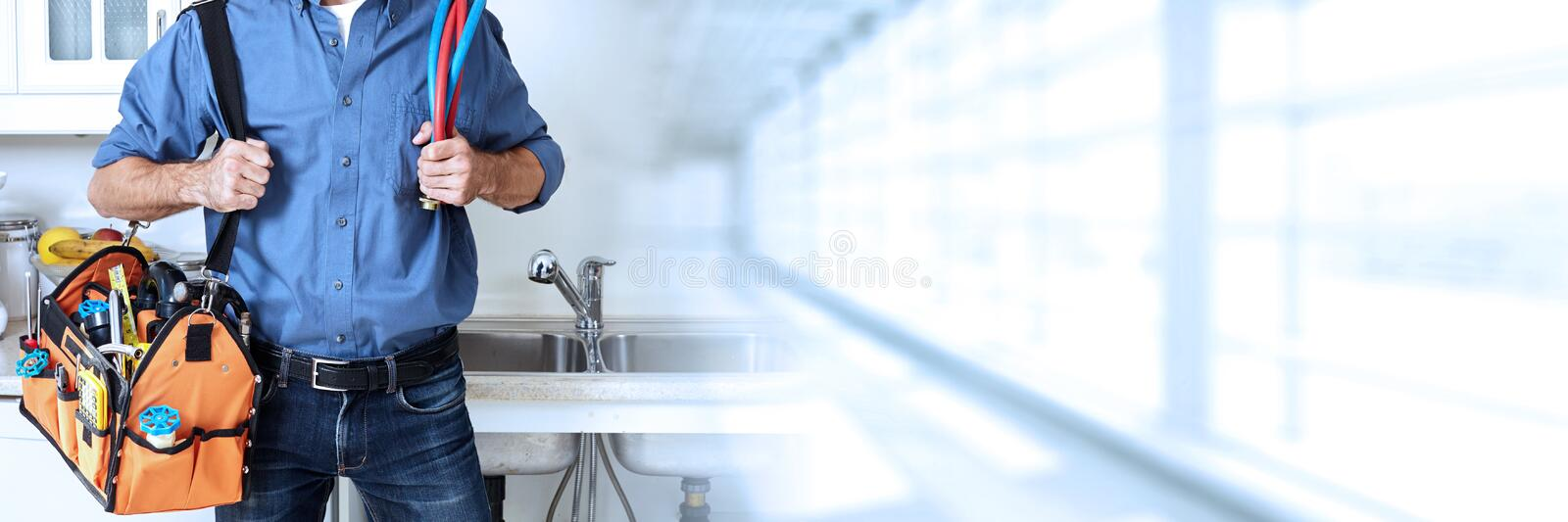 Plumber. Professional plumber working renovation in kitchen home stock photo