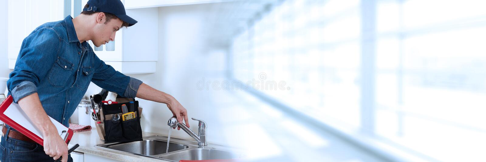 Plumber. Professional plumber working renovation in kitchen home royalty free stock photography