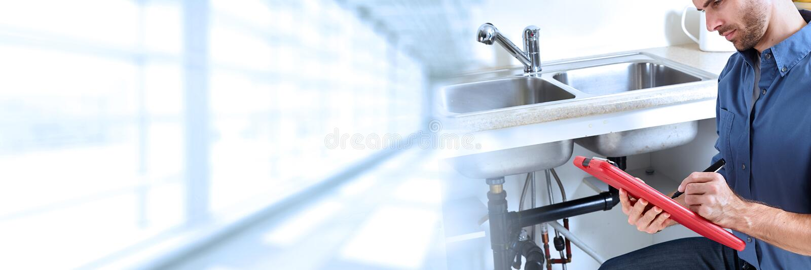 Plumber. Professional plumber working renovation in kitchen home stock images