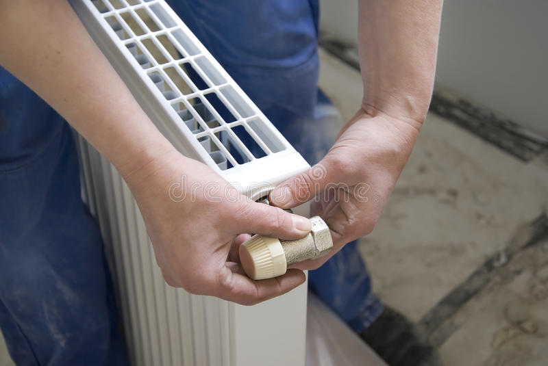 Plumber radiator royalty free stock image