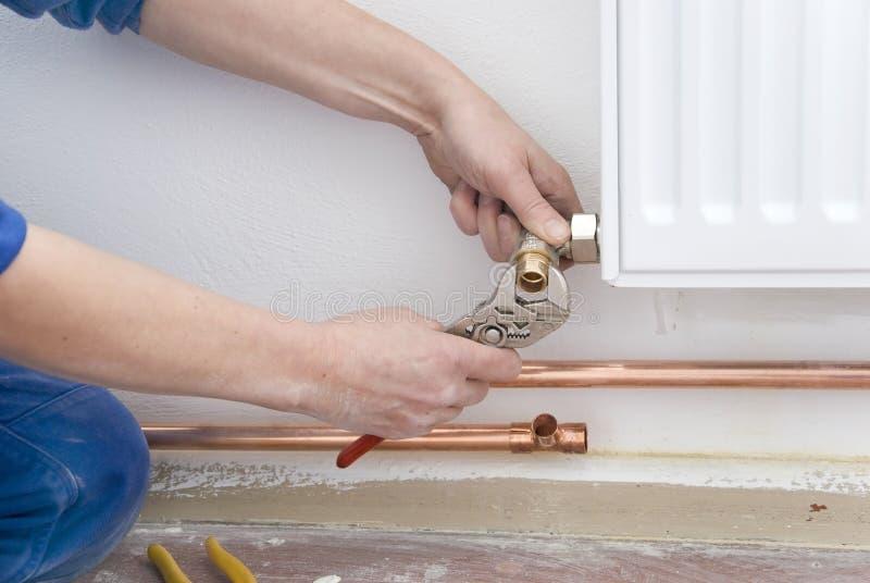 Plumber radiator stock photos