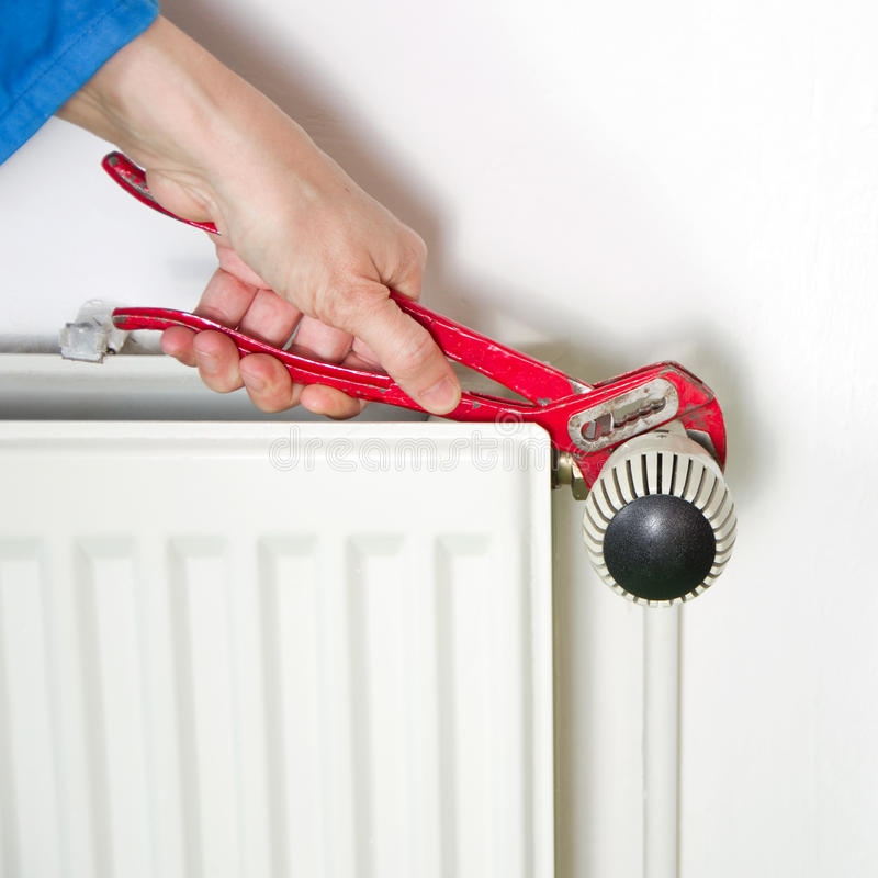 Plumber and radiator royalty free stock photo