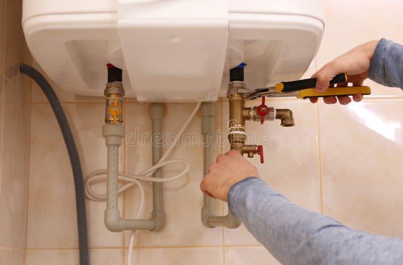 Plumber repairing boiler royalty free stock images