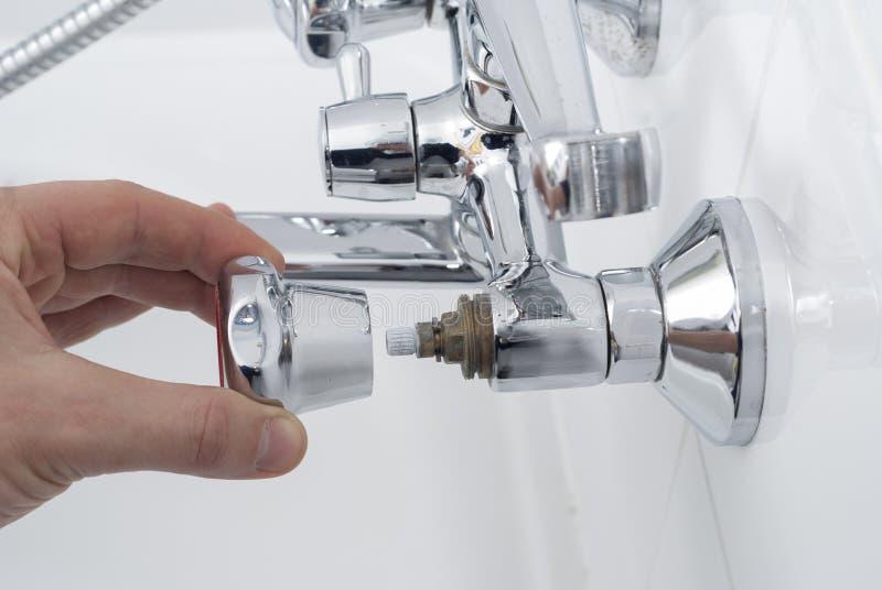 Repair of a water tap stock photo. Image of broken, person - 107204166