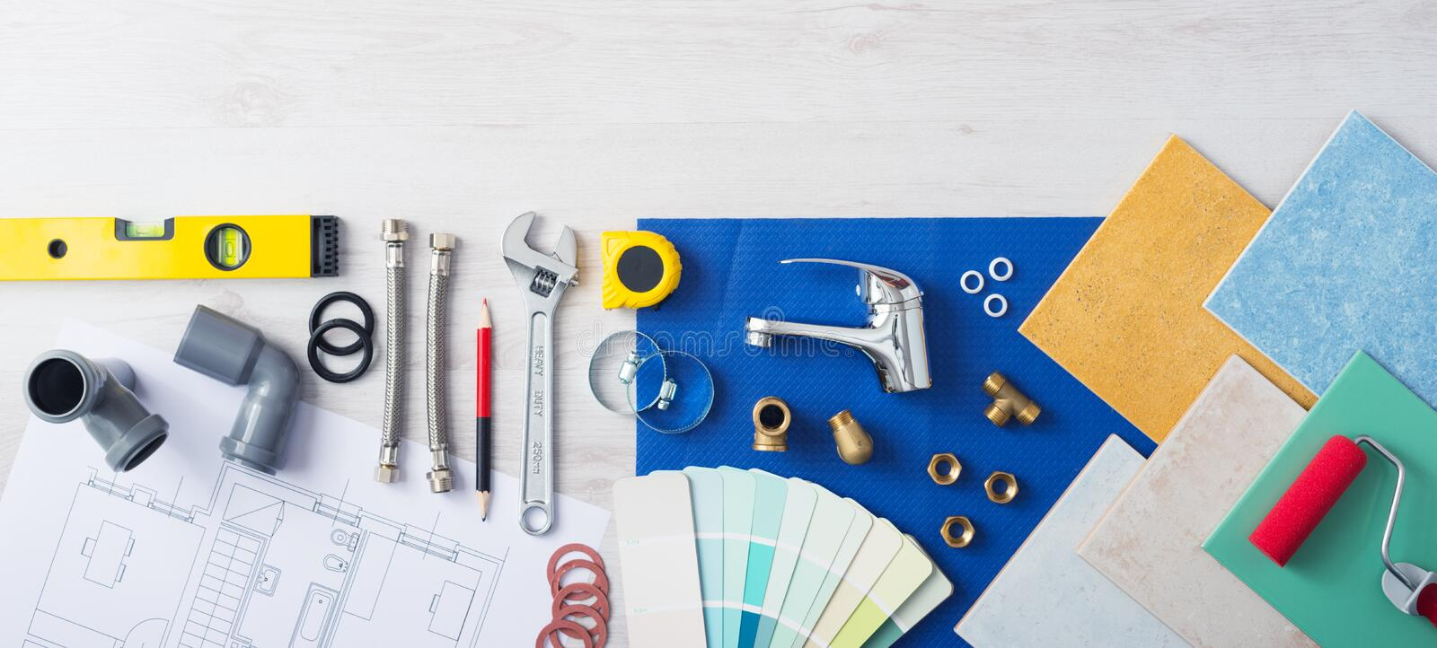 Plumber's work table. Banner with work tools, faucet, tiles and color swatches, top view stock images