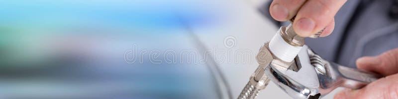 Plumber screwing plumbing fittings stock photography