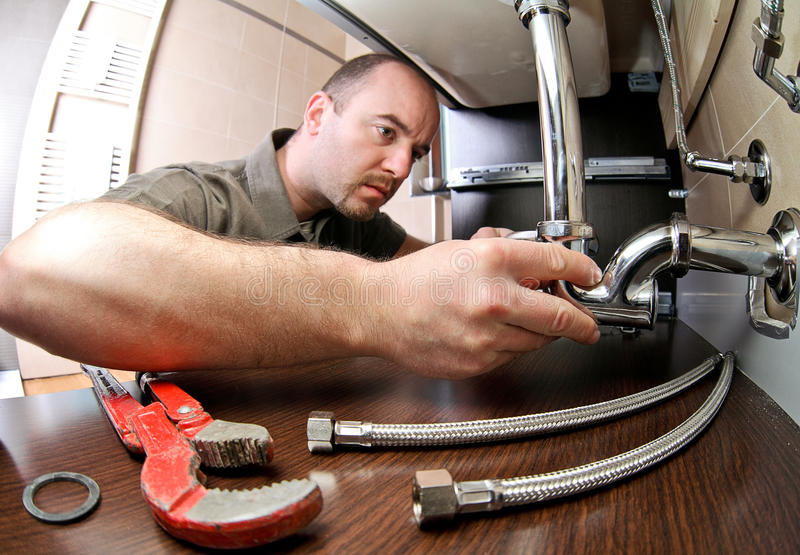 Plumber ta work stock photo