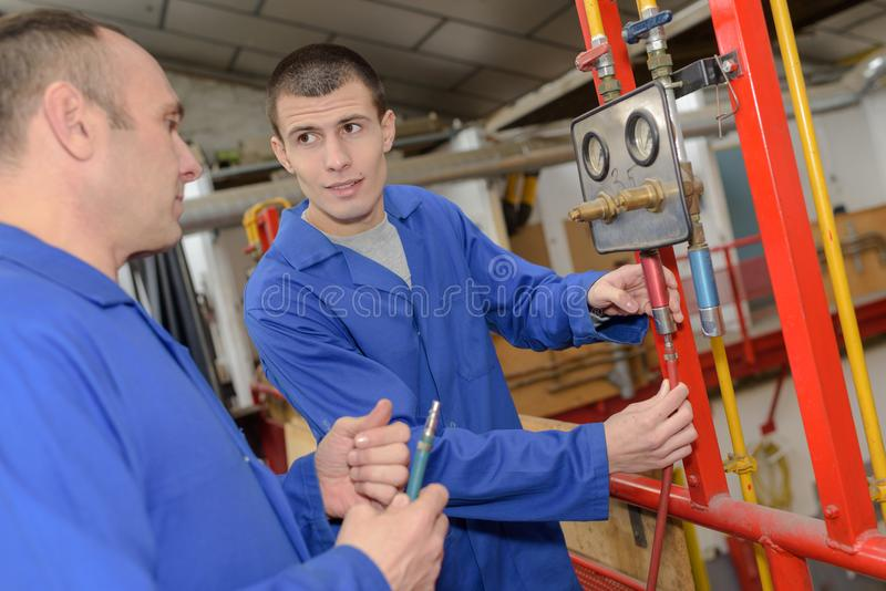 Plumber teaching apprentice trade stock photography