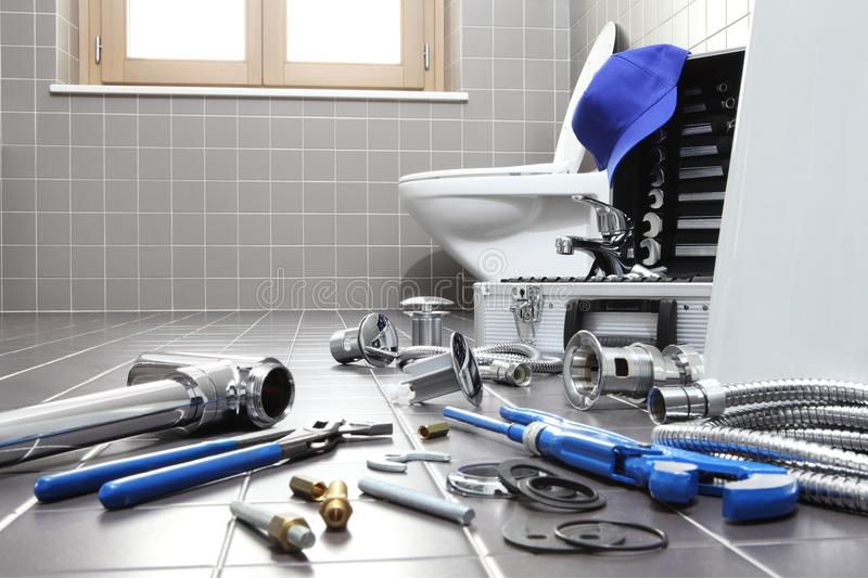 Plumber tools and equipment in a bathroom, plumbing repair servi. Ce, assemble and install concept royalty free stock photography