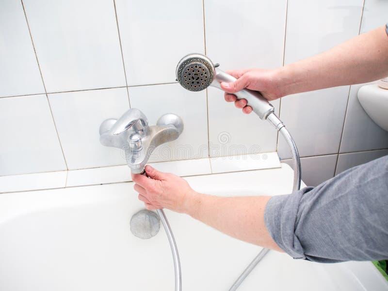 plumber-unscrewing-shower-hose-plumber-u