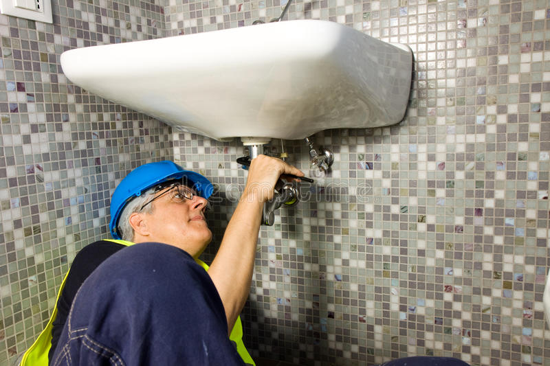 Plumber at work. With faucet and tap royalty free stock photos