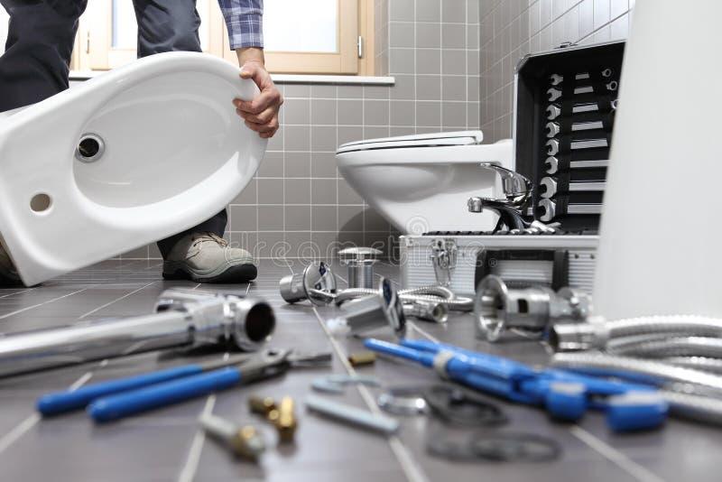 Download Plumber At Work In A Bathroom, Plumbing Repair Service, Assemble  Stock Photo