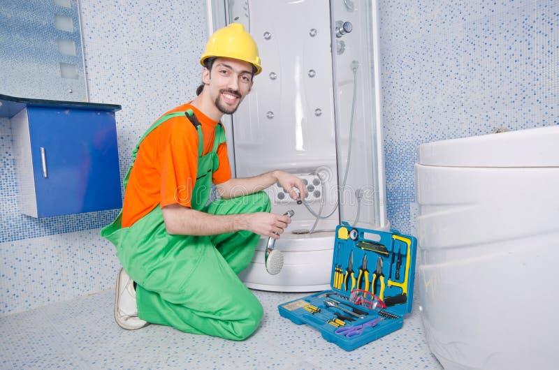 Download Plumber Working In  Bathroom Stock Photo - Image: 24758806