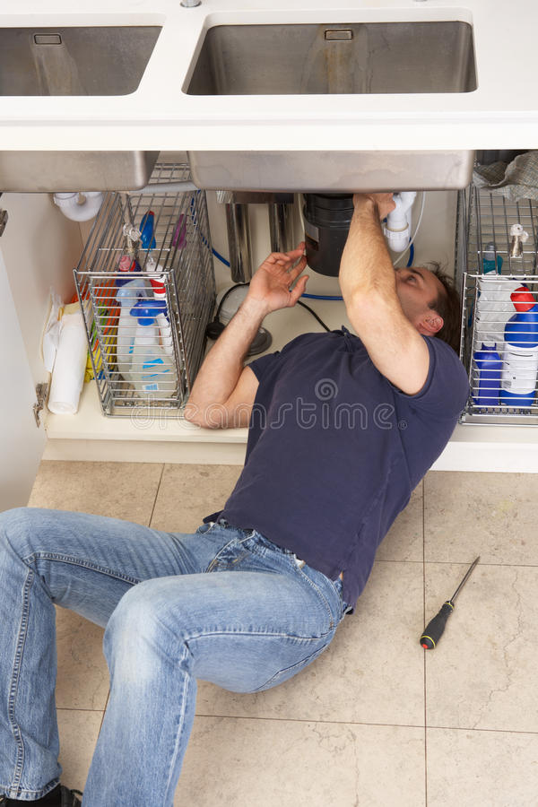 Plumber Working On Sink royalty free stock photography