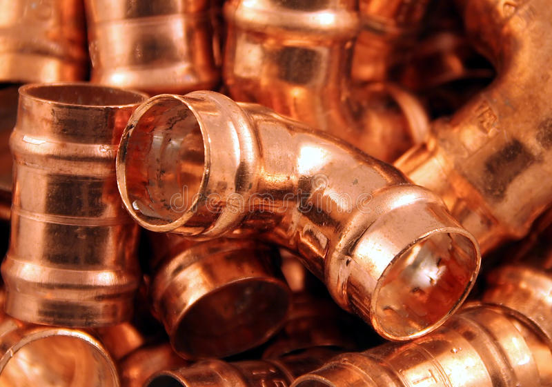 Plumbers copper fittings. A pile of 15mm yorkshire solder fixings for copper pipes royalty free stock photography