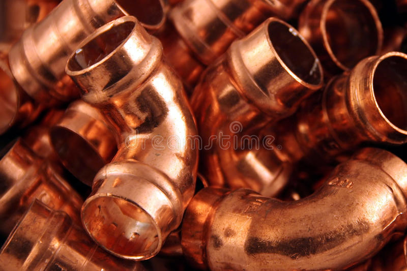 Plumbers copper fittings. A pile of 15mm yorkshire solder fixings for copper pipes stock image