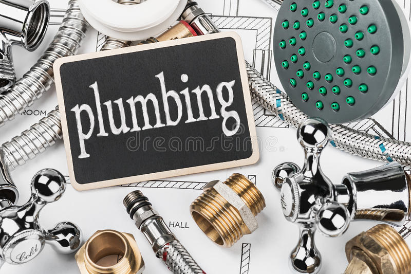 Plumbing and blackboard royalty free stock image
