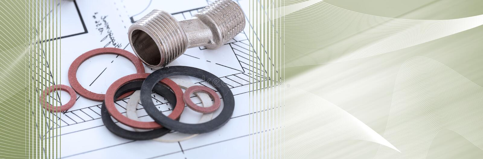 Plumbing fittings and gaskets; panoramic banner. Plumbing fittings and gaskets on a plan; panoramic banner stock photo