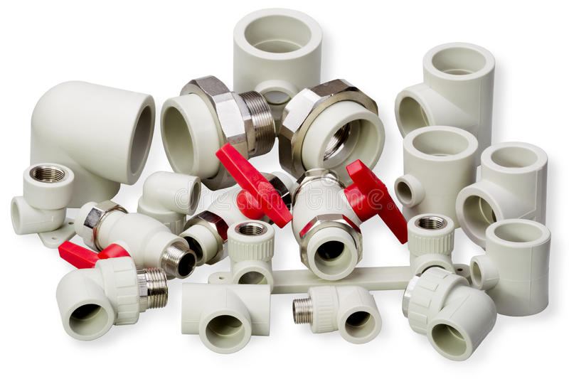 Plumbing fixtures and piping parts. Plastic fittings royalty free stock images