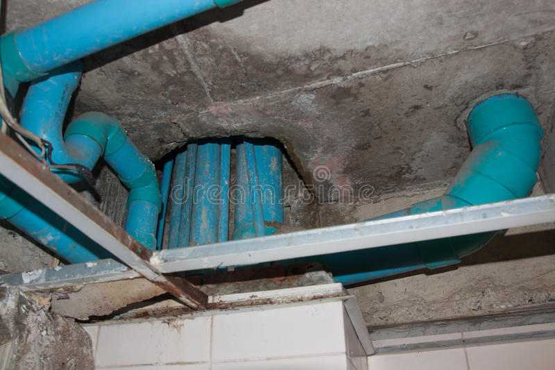 Plumbing fixtures PVC cement under the ceiling. stock photos