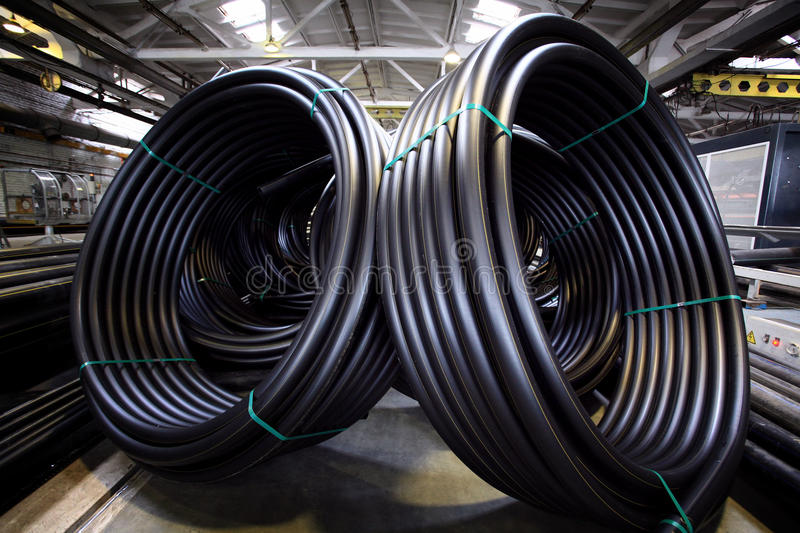 Plumbing pipes, industry, manufacture of pipes. Factory royalty free stock image