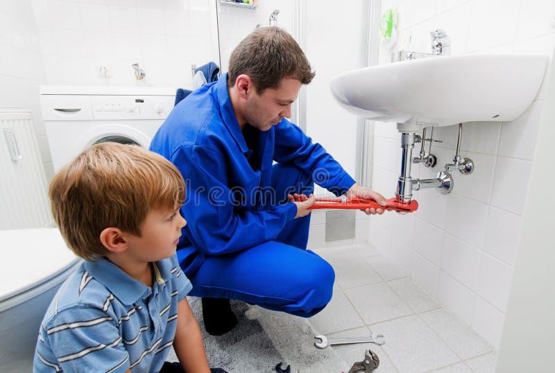 Plumbing repair sink stock photo