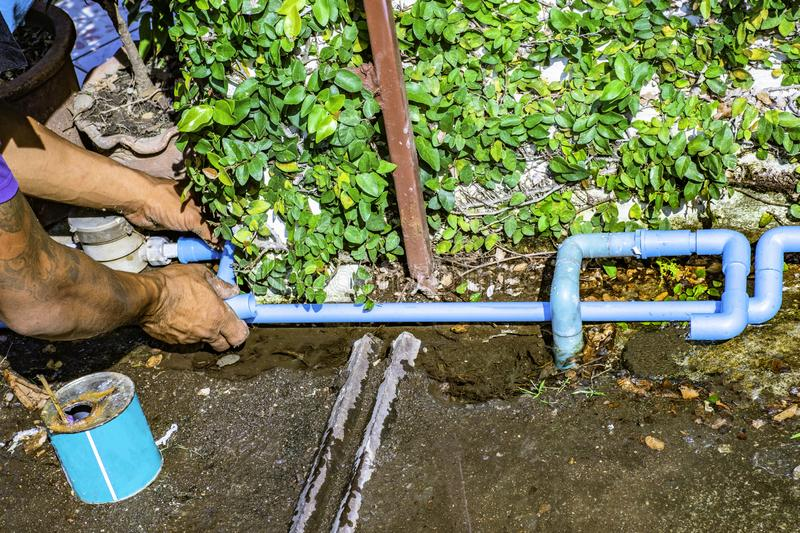 Plumbing repair by skilled technicians. stock images