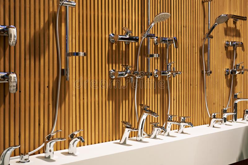 Plumbing shower faucets in store royalty free stock photography