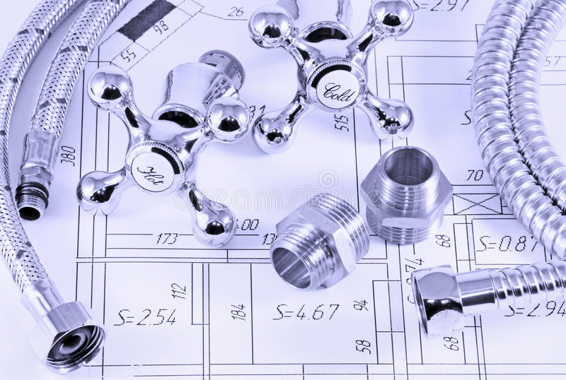 Plumbing in terms. Different plumbing and metal accessories on the layout of apartments