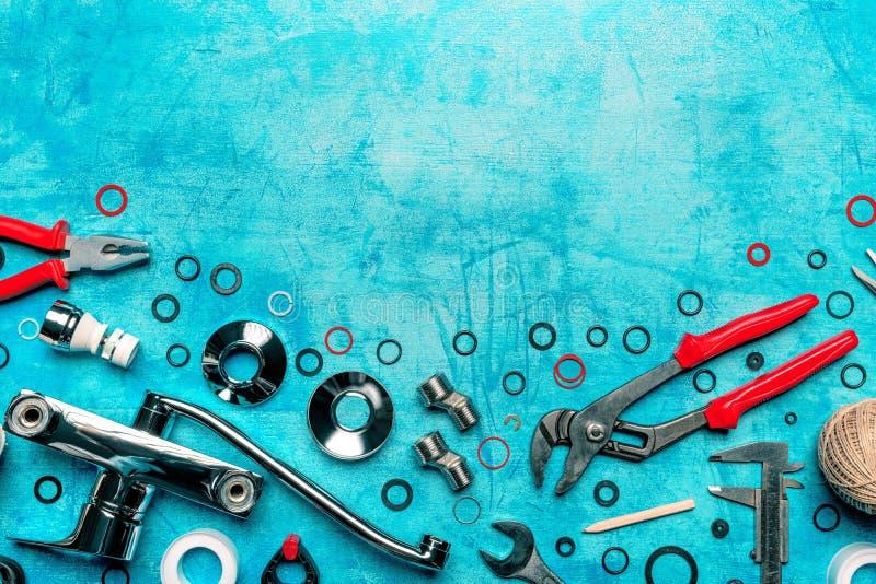 Plumbing toolkit on work desk top view flat lay royalty free stock image
