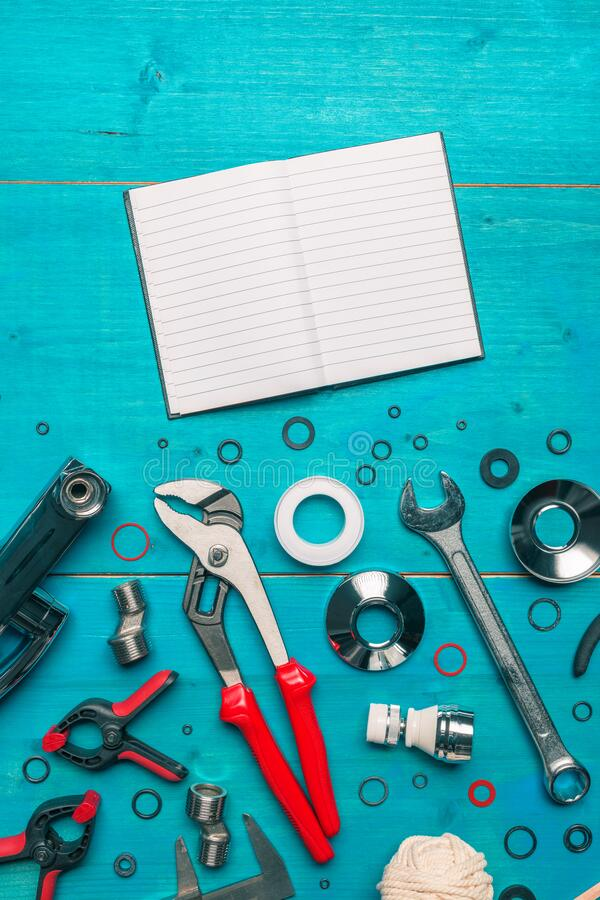 Plumbing tools and blank notebook mock up stock photo
