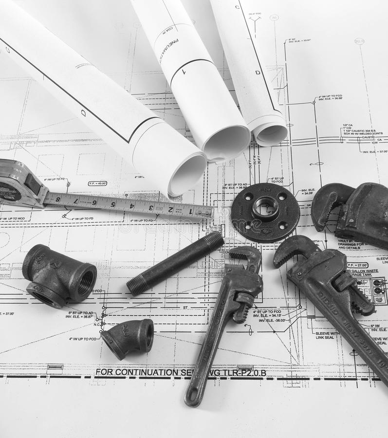 Plumbing tools on blueprints 1 stock photos