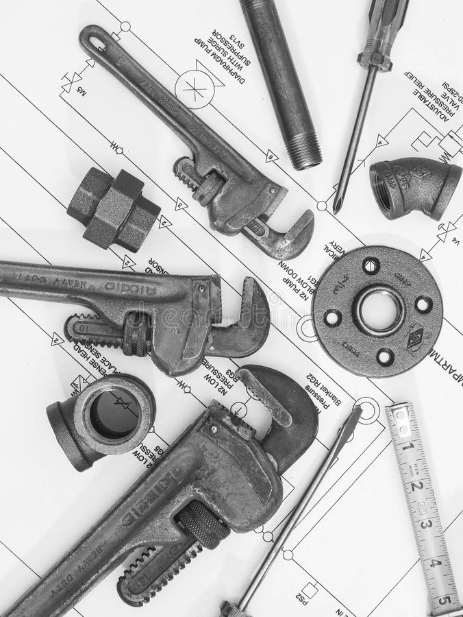 Plumbing tools on blueprints 2 royalty free stock images