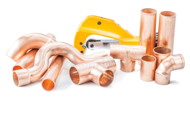 Plumbing tools copper pipes fittings and pipe cutter isolated stock image