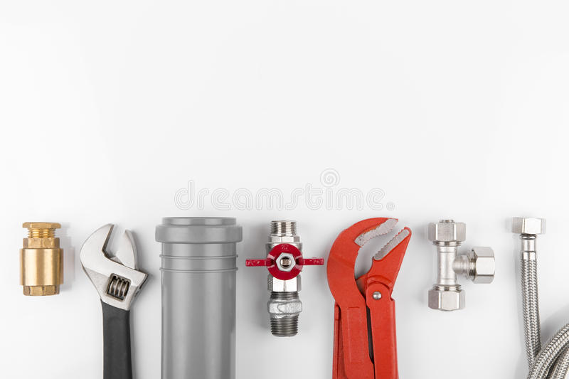 Plumbing tools and equipment on white with copy space. Plumbing tools and equipment on white background with copy space royalty free stock photos