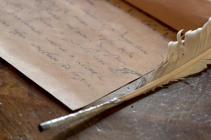 Plume and hand written letter. Detail stock photography
