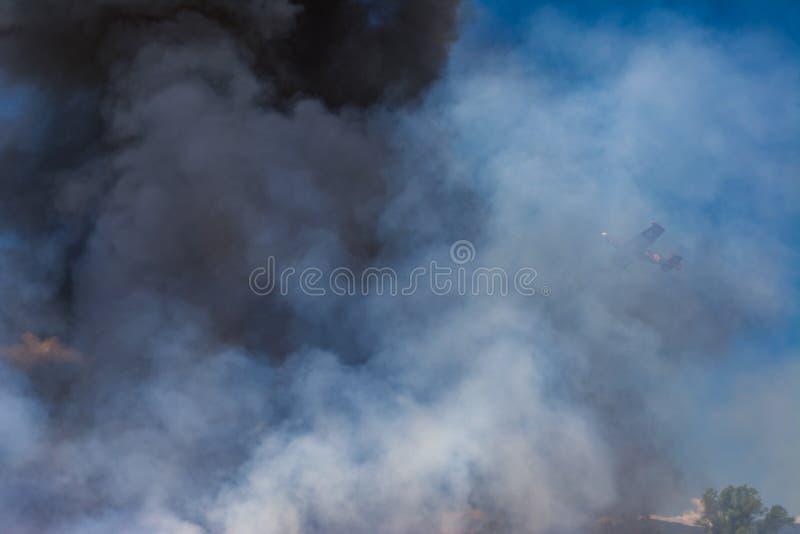 A plume of smoke. Propeller plane on a plume of smoke stock image