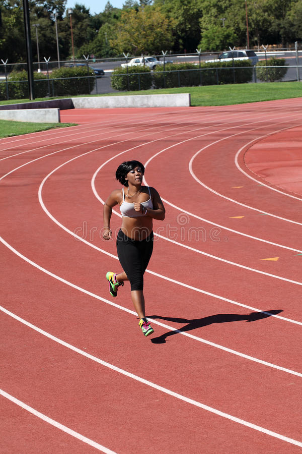 Download Plump Young Black Woman Running On Track Stock Photo - Image: 21701076