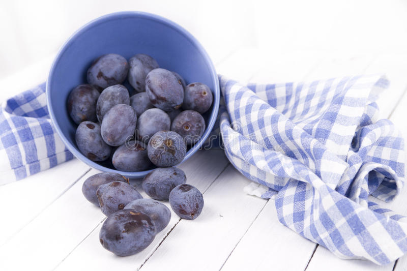 Plums in a fruit bowl royalty free stock photo