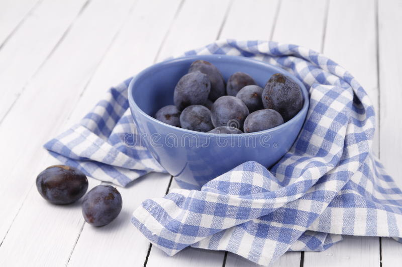 Plums in a fruit bowl royalty free stock image