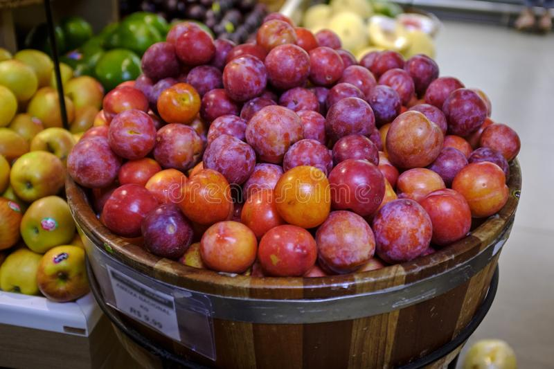 Plums for sale in the market royalty free stock photos