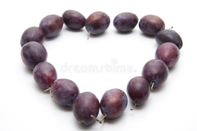 Plums With Stem In Heart Form Stock Photos