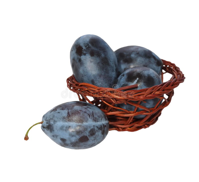 Plums With Wicker Baskets Isolated Stock Photo