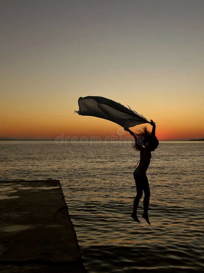 Plunge into the sea sunset royalty free stock photo