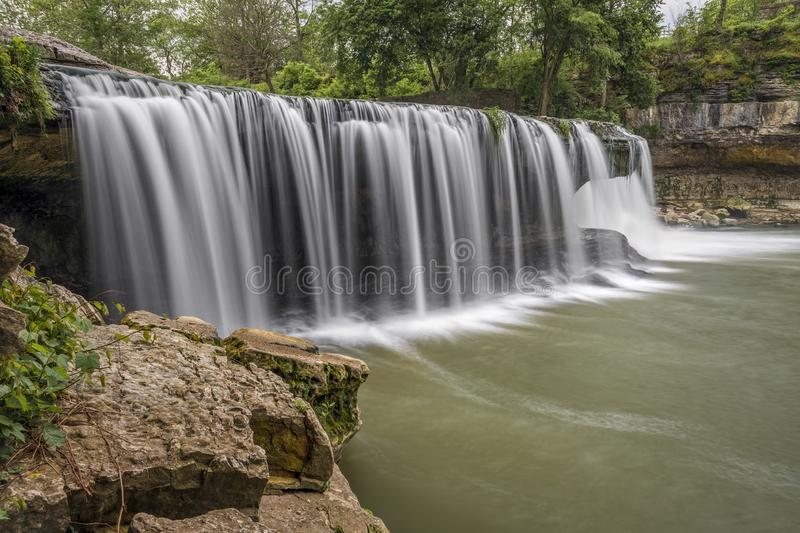 Plunging Indiana Waterfall - Upper Cataract Falls. Mill Creek plunges over Upper Cataract Falls, a beautiful waterfall in rural Owen County, Indiana royalty free stock photo