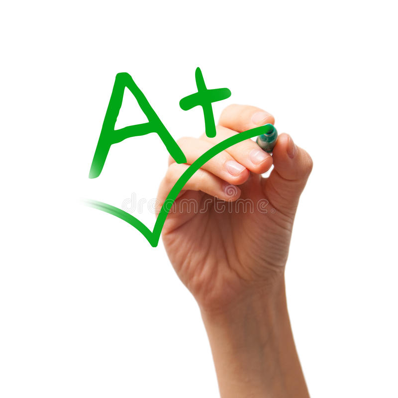 A plus grade. Written with a green marker on white background royalty free stock photo