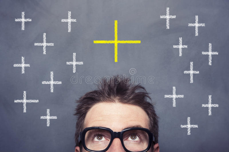 Plus Sign. And man front of the blackboard royalty free stock photo