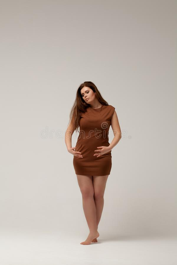 Plus Size Fashion Model In Brown Short Dress Stock Photo ...