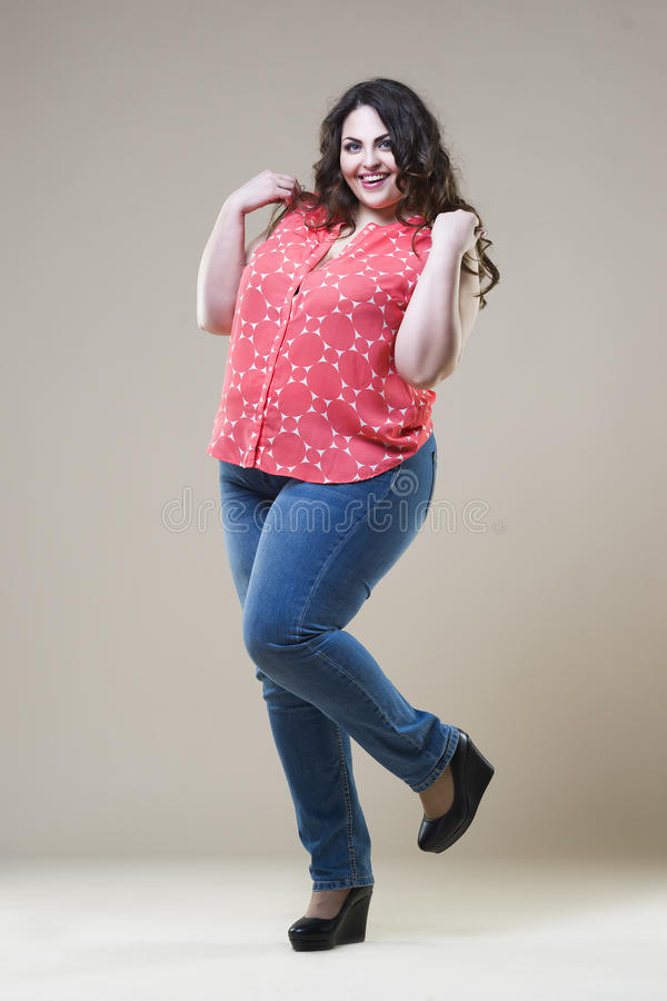 Plus size fashion model in casual clothes, fat woman on studio background, overweight female body stock photos