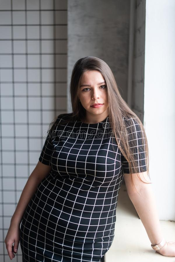 Plus size fashion model in casual clothes, woman on studio background, overweight female body stock images